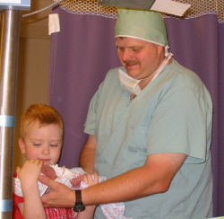 Steve and Nathan holding Abigail